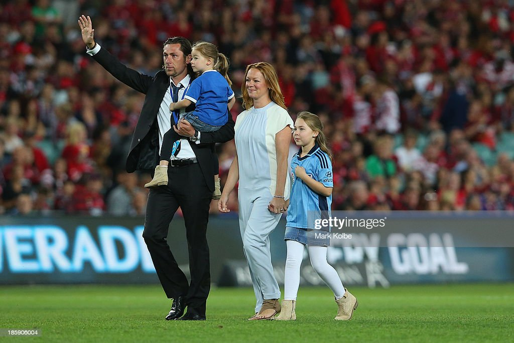 Former Sydney FC player Pascal Bosschaart walks with his family on the pitch and waves farewell to the crowd after mutually agreeing to part ways with the club earlier in the week during the round three A-League match between Sydney FC and the Western Sydney Wanderers at Allianz Stadium on October 26, 2013 in Sydney, Australia.