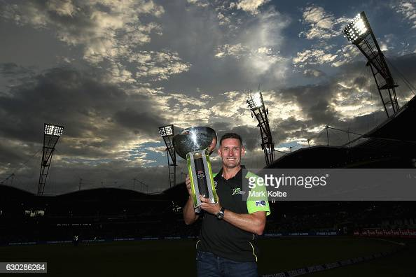 Former Sydney Thunder captain Michael Hussey poses with the 2015/16 Big Bash trophy the Big Bash League match between the Sydney Thunder and the...