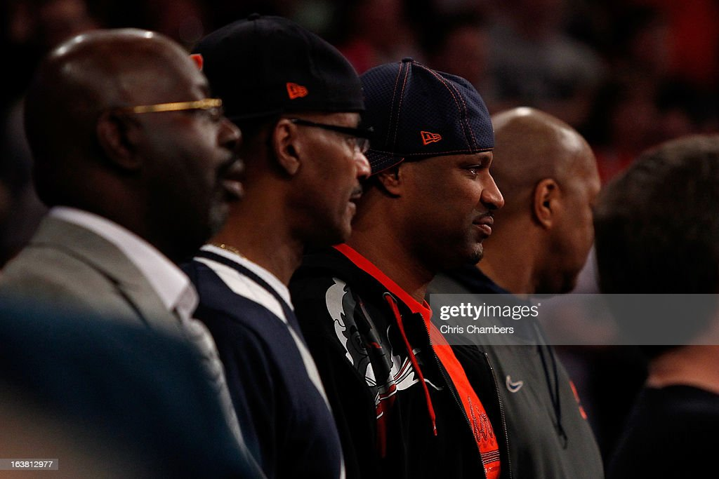 Former Syracuse Orange player Billy Owens (2nd R) attends the Syracuse game against the Georgetown Hoyas during the semifinals of the Big East Men's Basketball Tournament at Madison Square Garden on March 15, 2013 in New York City.