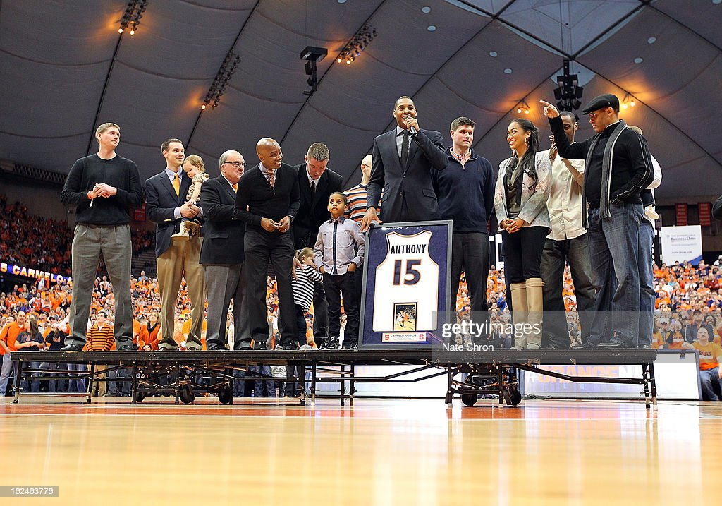 Former Syracuse Orange player <a gi-track='captionPersonalityLinkClicked' href=/galleries/search?phrase=Carmelo+Anthony&family=editorial&specificpeople=201494 ng-click='$event.stopPropagation()'>Carmelo Anthony</a> (C) looks on with athletic director Daryl Gross, son Kiyan <a gi-track='captionPersonalityLinkClicked' href=/galleries/search?phrase=Carmelo+Anthony&family=editorial&specificpeople=201494 ng-click='$event.stopPropagation()'>Carmelo Anthony</a> and wife Alani Vasquez along with members of the 2003 national champions team in a presenation retiring his jersey, #15 during half time in the game against the Georgetown Hoyas at the Carrier Dome on February 23, 2013 in Syracuse, New York.