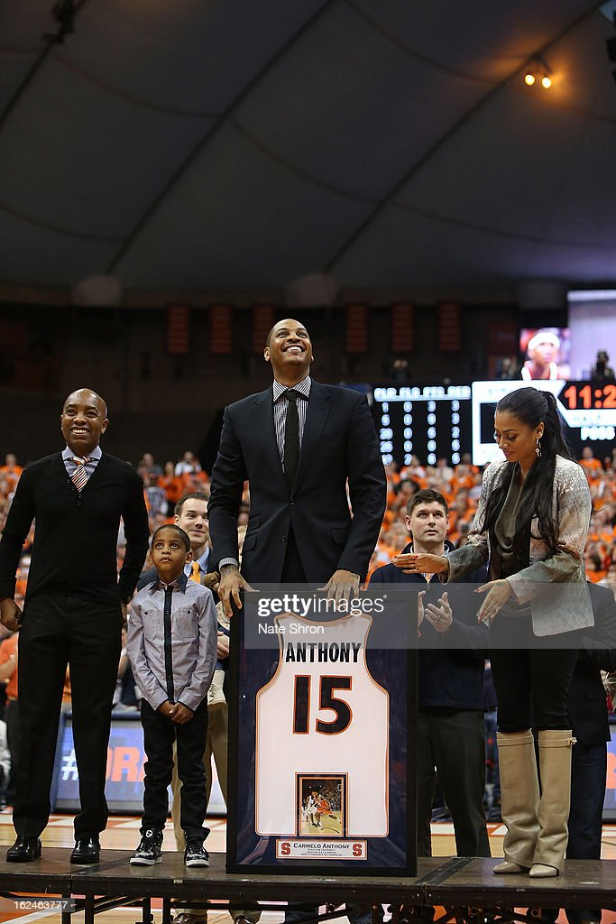 Former Syracuse Orange player Carmelo Anthony (C) looks on with athletic director Daryl Gross, son Kiyan Carmelo Anthony and wife Alani Vasquez along with members of the 2003 national champions team in a presenation retiring his jersey, #15 during half time in the game against the Georgetown Hoyas at the Carrier Dome on February 23, 2013 in Syracuse, New York.