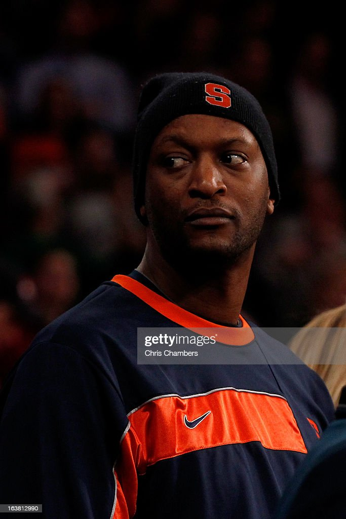 Former Syracuse Orange player John Wallace (2nd R) attends the Syracuse game against the Georgetown Hoyas during the semifinals of the Big East Men's Basketball Tournament at Madison Square Garden on March 15, 2013 in New York City.