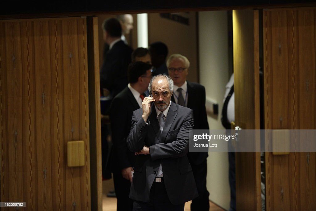 Former Syrian National Coalition President Moaz al-Khatib speaks on the phone before a United Nations Security Council vote September 27, 2013 at U.N. headquarters in New York City. The Security Council today voted unanimously on a resolution that compels Syria to give up its chemical-weapon stockpile or face consequences. To that end, it requires unfettered access to international chemical-weapons experts, according to published reports.