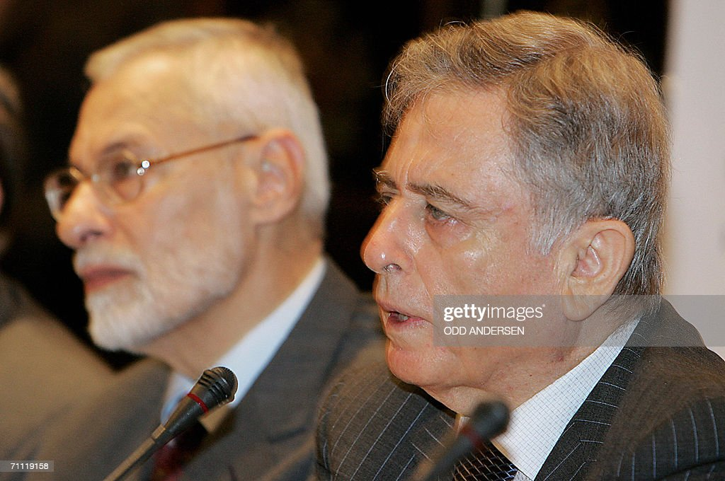 Former Syrian vicepresident Abdul Halim Khaddam makes the opening remarks seated next to leader of the muslim brotherhood in Syria Ali Sadreddin...