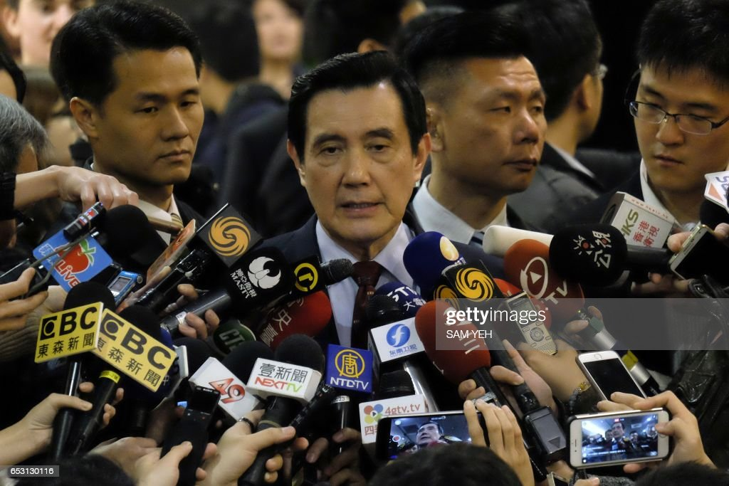 Former Taiwan president Ma Ying-jeou speaks to the press after a speech to the Harvard College Asia Program in Taipei on March 14, 2017. Taiwan's former president Ma Ying-jeou was slapped with new charges on March 14 in a political leaks controversy, just weeks before he faces possible conviction in another related case. / AFP PHOTO / Sam YEH