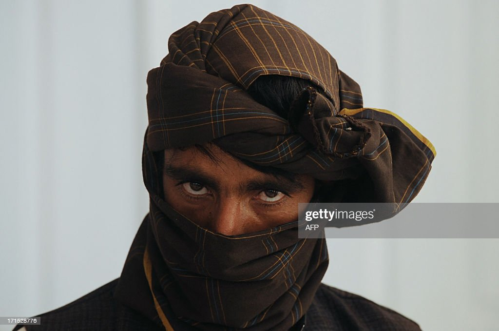 A former Taliban fighter looks on after he joined Afghan government forces during a ceremony in Herat on on June 26 2013 About 100000 foreign combat...