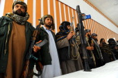 Former Taliban fighters stand with their weapons in Herat province on March 1 2014 An elevenmember armed group of Taliban have joined the government...