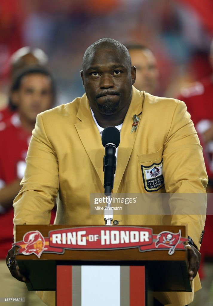 Former Tampa Bay Buccaneer <a gi-track='captionPersonalityLinkClicked' href=/galleries/search?phrase=Warren+Sapp&family=editorial&specificpeople=162706 ng-click='$event.stopPropagation()'>Warren Sapp</a> speaks at a ceremony retiring his number during a game against the Miami Dolphins at Raymond James Stadium on November 11, 2013 in Tampa, Florida.