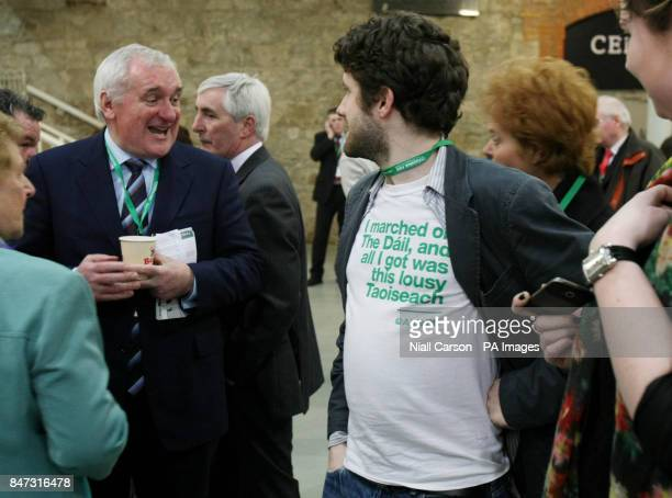 Former Taoiseach Bertie Ahern shares a joke with comedian Abie Philbin Bowman as he arrives at the RDS in Dublin for the Fianna Fail Ard Fheis