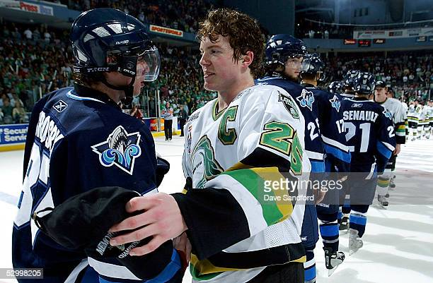Former Team Canada teammates Danny Syvret of the London Knights and Sidney Crosby of the Rimouski Oceanic shake hands after the Knights defeated...