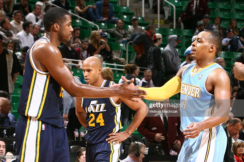 Former teammates, <a gi-track='captionPersonalityLinkClicked' href=/galleries/search?phrase=Derrick+Favors&family=editorial&specificpeople=5792014 ng-click='$event.stopPropagation()'>Derrick Favors</a> #15 of the Utah Jazz and <a gi-track='captionPersonalityLinkClicked' href=/galleries/search?phrase=Randy+Foye&family=editorial&specificpeople=240185 ng-click='$event.stopPropagation()'>Randy Foye</a> #4 of the Denver Nuggets greet each other after the game at EnergySolutions Arena on November 11, 2013 in Salt Lake City, Utah.