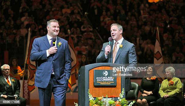 Former teammates Eric Lindros and John LeClair share a laugh during their Philadelphia Flyers Hall of Fame Induction Ceremony prior to the Flyers...