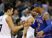 Former teammates Jeremy Lin of the Charlotte Hornets and Carmelo Anthony of the New York Knicks shake hands after the Hornets defeated the Knicks...