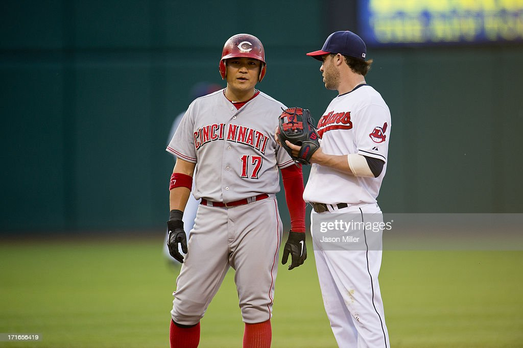 Former teammates <a gi-track='captionPersonalityLinkClicked' href=/galleries/search?phrase=Shin-Soo+Choo&family=editorial&specificpeople=196543 ng-click='$event.stopPropagation()'>Shin-Soo Choo</a> #17 of the Cincinnati Reds and <a gi-track='captionPersonalityLinkClicked' href=/galleries/search?phrase=Jason+Kipnis&family=editorial&specificpeople=5330784 ng-click='$event.stopPropagation()'>Jason Kipnis</a> #22 of the Cleveland Indians chat during the game against the Cleveland Indians at Progressive Field on May 30, 2013 in Cleveland, Ohio.