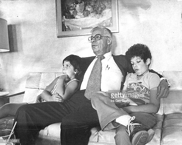 JUL 24 1977 Former television newscaster Daniel Schorr on his way to vacation in Aspen Colo rests with his children Lisa and Jonathon