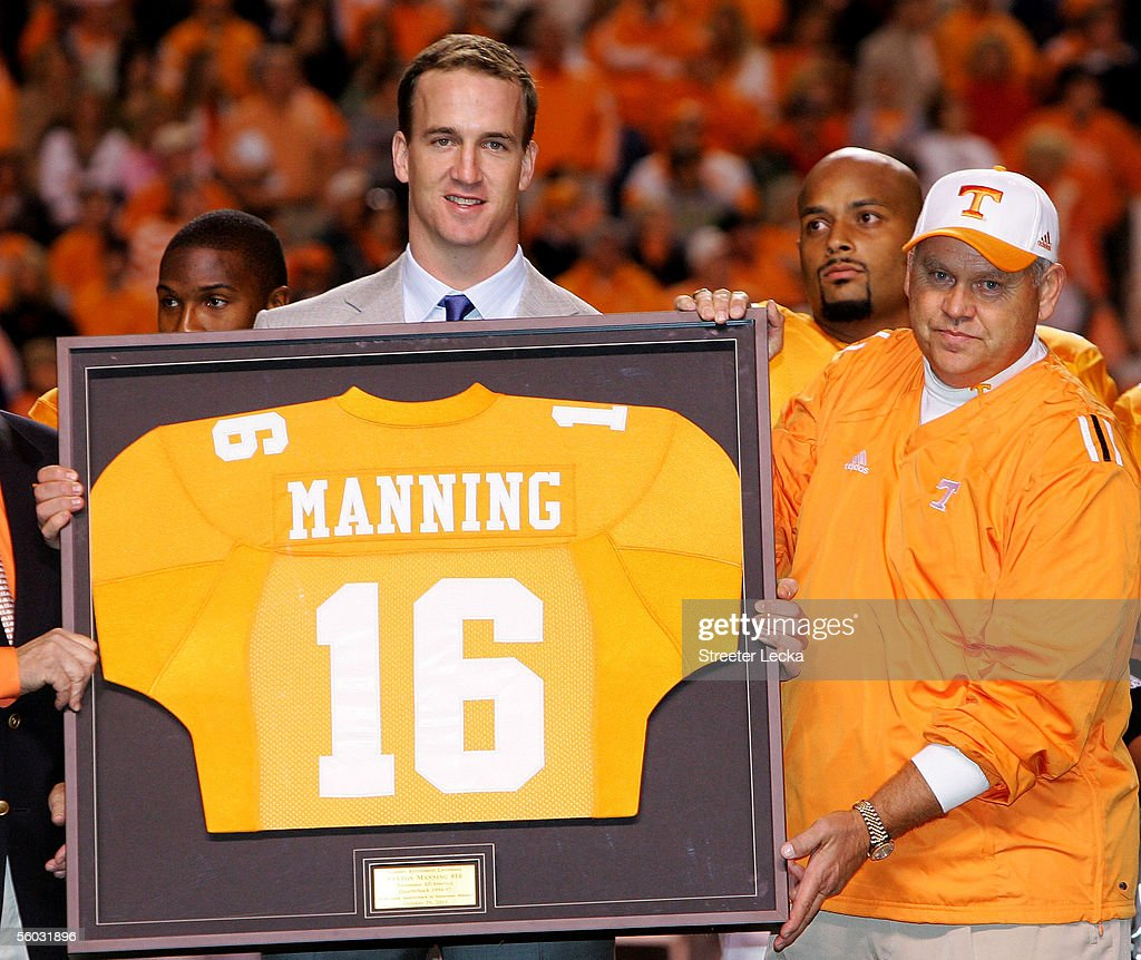 Former Tennesse quarterback <a gi-track='captionPersonalityLinkClicked' href=/galleries/search?phrase=Peyton+Manning&family=editorial&specificpeople=184524 ng-click='$event.stopPropagation()'>Peyton Manning</a> and current quarterback for the Indianapolis Colts is honored alongside his former college coach Phillip Fulmer before the start of the game against the South Carolina Gamecocks on October 29, 2005 at Neyland Stadium in Knoxville, Tennessee.