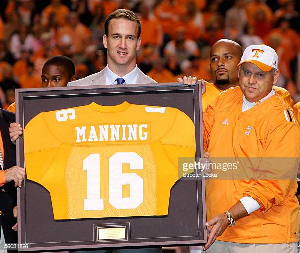 Former Tennesse quarterback Peyton Manning and current quarterback for the Indianapolis Colts is honored alongside his former college coach Phillip...