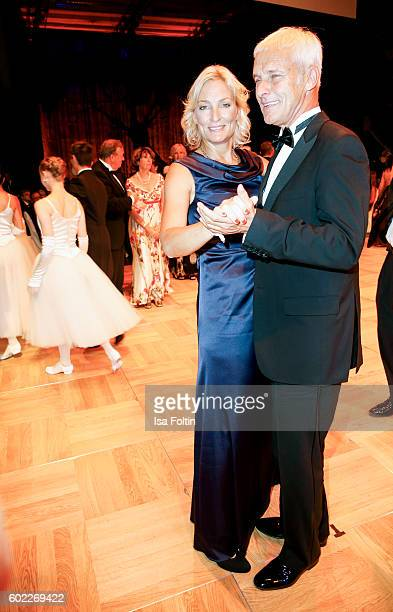 Former Tennis Player and Captain German Federation Cup Team Barbara Rittner and her boyfriend Matthias Mueller chairman Volkswagen AG dance during...