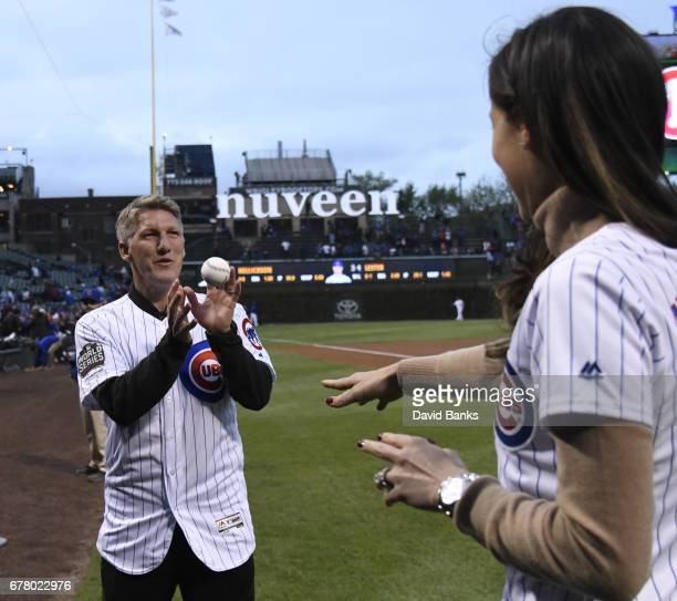 Former tennis player and French Open champion Ana Ivanovic and Chicago Fire Soccer player Bastian Schweinsteiger on the field before the game between...