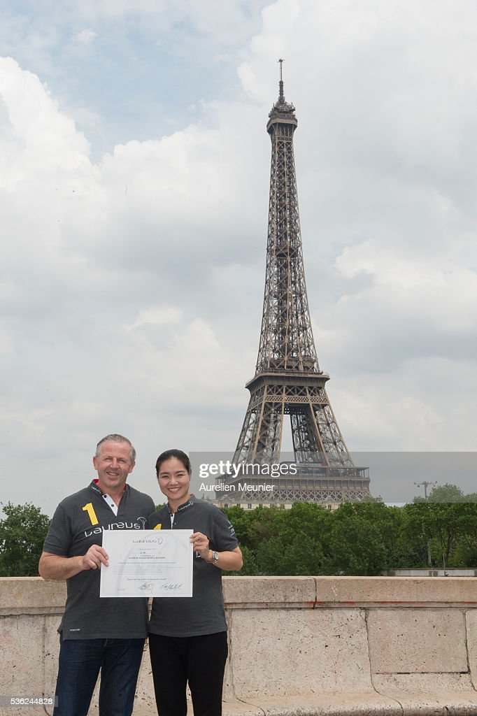 Former Tennis player and new Laureus Academy Member Li Na with Laureus Academy Member <a gi-track='captionPersonalityLinkClicked' href=/galleries/search?phrase=Sean+Fitzpatrick&family=editorial&specificpeople=228921 ng-click='$event.stopPropagation()'>Sean Fitzpatrick</a> pose with her certificate during the Li Na Laureus Academy Member Announcement at the Eiffel Tower on May 27, 2016 in Paris,France.