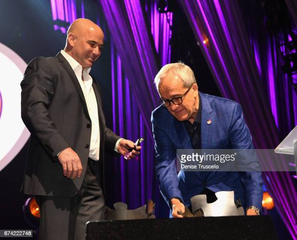 Former tennis player Andre Agassi accepts the Community Achievement Award from Keep Memory Alive CoFounder Larry Ruvo during the 21st annual Keep...