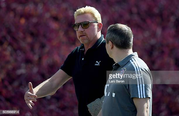 Former tennis player Boris Becker is seen with doctor Volker Braun during a training session at day three of the Bayern Muenchen training camp at...
