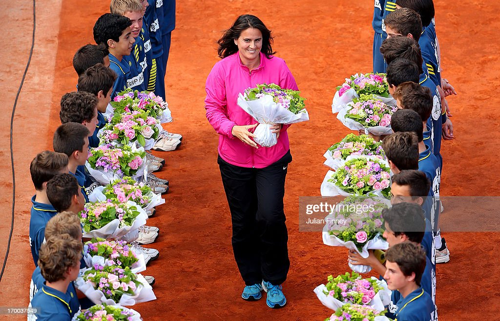 Former tennis player <a gi-track='captionPersonalityLinkClicked' href=/galleries/search?phrase=Conchita+Martinez&family=editorial&specificpeople=184563 ng-click='$event.stopPropagation()'>Conchita Martinez</a> walks through a guard of honour formed by some of the tournament's ballboys on Philippe-Chatrier court to celebrate the 40th anniversary of the WTA during day twelve of the French Open at Roland Garros on June 6, 2013 in Paris, France.