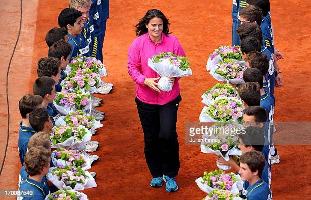 Former tennis player Conchita Martinez walks through a guard of honour formed by some of the tournament's ballboys on PhilippeChatrier court to...