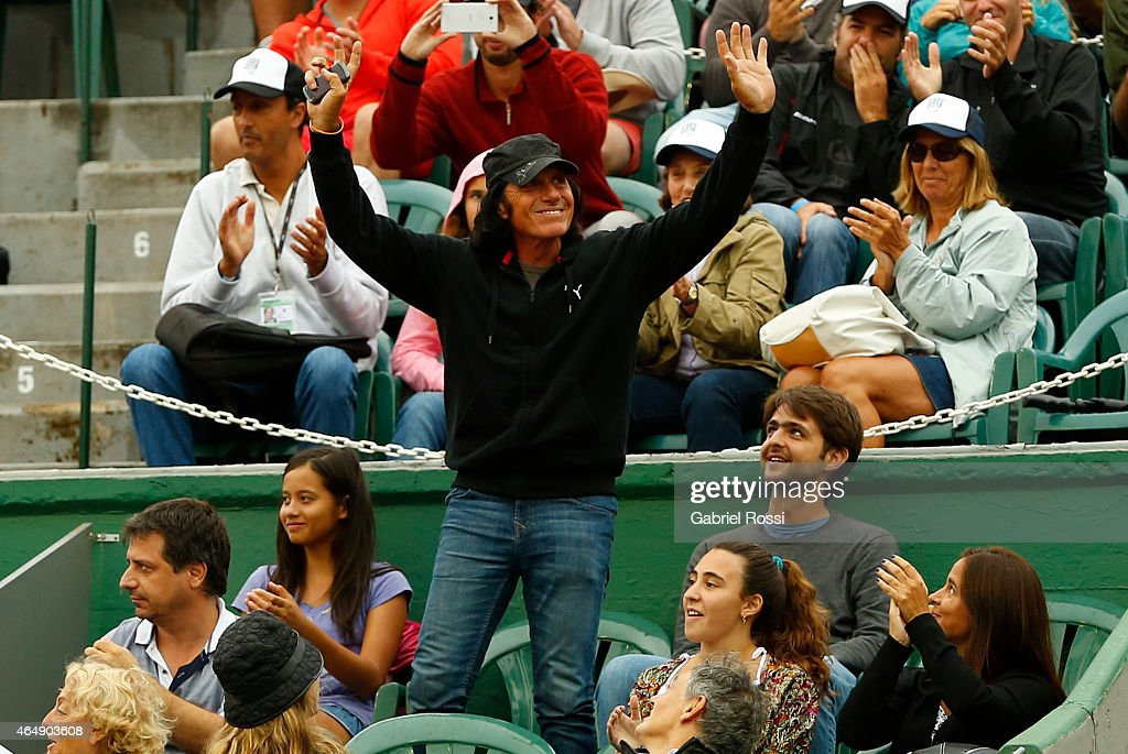 Former tennis player <a gi-track='captionPersonalityLinkClicked' href=/galleries/search?phrase=Guillermo+Vilas&family=editorial&specificpeople=605489 ng-click='$event.stopPropagation()'>Guillermo Vilas</a> greets the crowd during a singles final match between Rafael Nadal of Spain and Juan Monaco of Argentina as part of ATP Argentina Open at Buenos Aires Lawn Tennis Club on March 01, 2015 in Buenos Aires, Argentina.