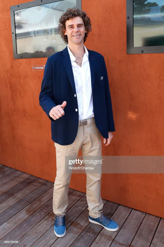 Former tennis player <a gi-track='captionPersonalityLinkClicked' href=/galleries/search?phrase=Gustavo+Kuerten&family=editorial&specificpeople=202975 ng-click='$event.stopPropagation()'>Gustavo Kuerten</a> attends the Men's Final of Roland Garros French Tennis Open 2014 - Day 15 on June 8, 2014 in Paris, France.