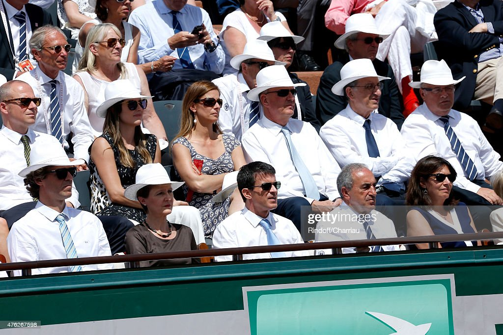 Former Tennis Player Gustavo Kuerten, President of the Swiss Confederation Simonetta Sommaruga', French Prime Minister Manuel Valls, President of French Tennis Federation Jean Gachassin, Mayor of Paris Anne Hidalgo, (2nd row, 3rd L-R) Miss valls, Violonist Anne Gravoin and President of France Television Remy Pflimlin attend the Men Final of 2015 Roland Garros French Tennis Open - Day Fithteen, on June 7, 2015 in Paris, France