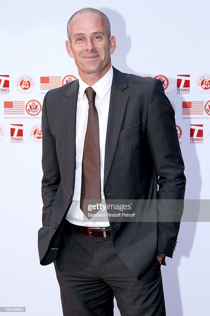 Former Tennis Player Guy Forget attends Annual Photocall for Roland Garros Tennis Players at 'Residence De L'Ambassadeur Des EtatsUnis' on May 24...