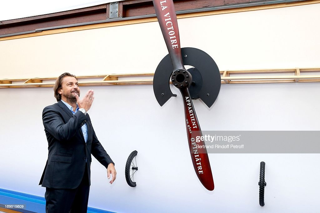 Former Tennis player <a gi-track='captionPersonalityLinkClicked' href=/galleries/search?phrase=Henri+Leconte&family=editorial&specificpeople=159217 ng-click='$event.stopPropagation()'>Henri Leconte</a> attends Roland Garros Tennis French Open 2013 - Day 1 on May 26, 2013 in Paris, France.