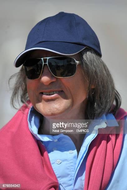 Former tennis player Ilie Nastase looks on