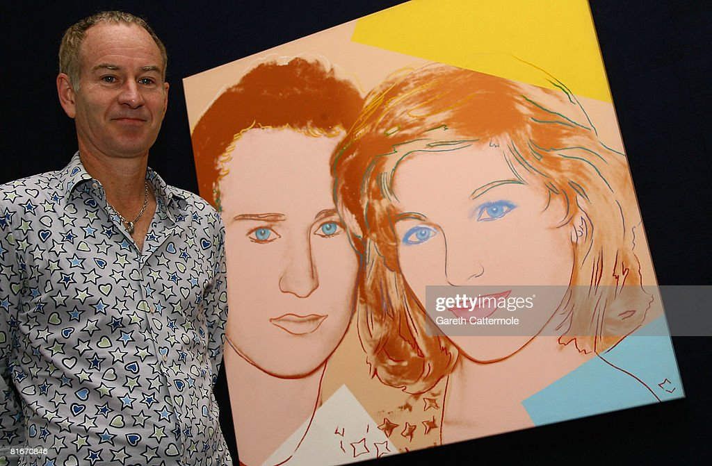 Former tennis player John McEnroe poses next to a 'Portrait of John McEnroe and Tatum O'Neal 1986' by Andy Warhol at Sotheby's on June 23, 2008 in London, England. The painting is estimated at GBP 250,000 - 300,000 and its proceeds will benefit the philanthropic organistation Habitat for Humanity.