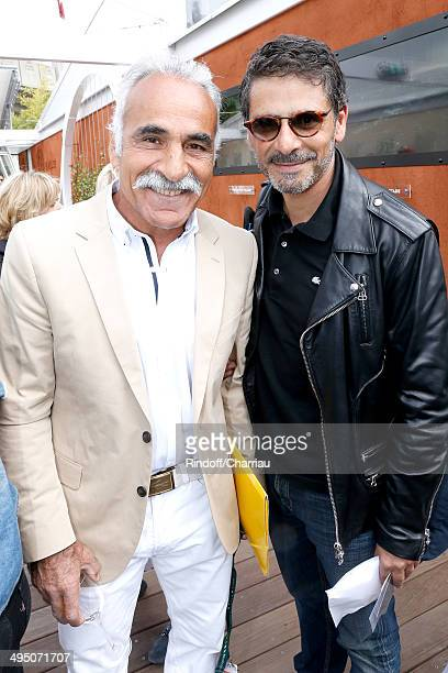 Former tennis player Mansour Bahrami and actor Pascal Elbe attend the Roland Garros French Tennis Open 2014 Day 8 on June 1 2014 in Paris France