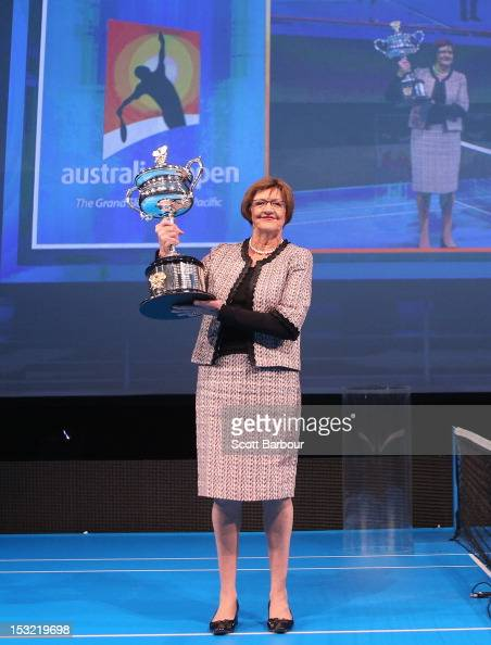 Former tennis player Margaret Court carries the Daphne Akhurst Trophy during the 2013 Australian Open launch at Melbourne Park on October 2 2012 in...