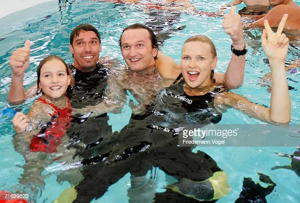 Former tennis player Michael Stich Sebastian van Almsick and Veronica Ferres pose after winning the 4 x 50m Freestyle Prominent Relay during the...