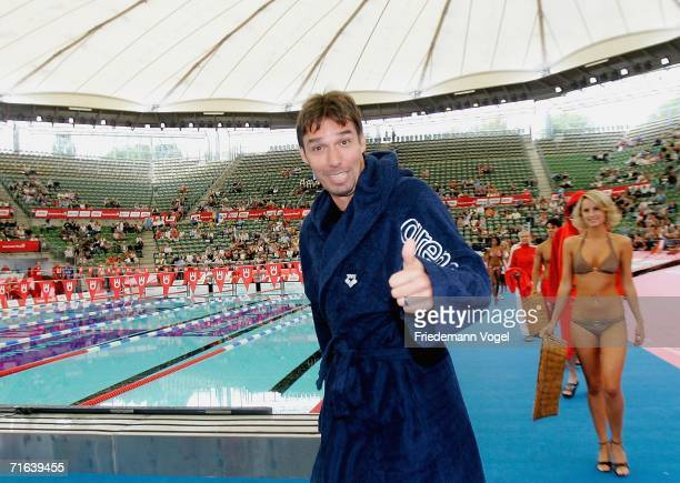 Former tennis player Michael Stich smiles for the fans before 4 x 50m Freestyle Prominent Relay during the second day of the Aquatics 2006 at the...