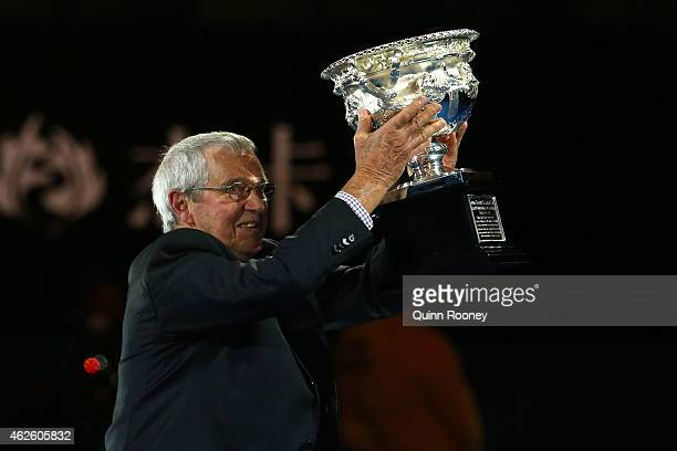Former tennis player Roy Emerson holds the Norman Brookes Challenge Cup ahead of men's final match during day 14 of the 2015 Australian Open at...