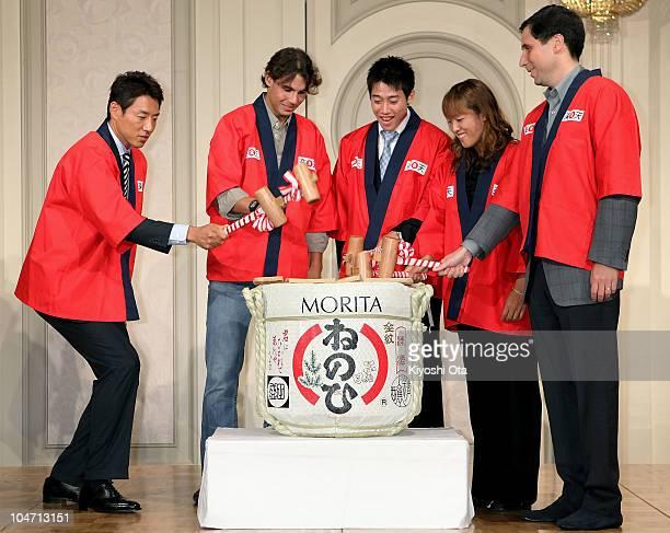 Former tennis player Shuzo Matsuoka Rafael Nadal of Spain Kei Nishikori of Japan and Ayumi Morita of Japan break open a sake barrel during a welcome...