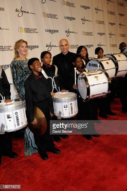 Former tennis player Steffi Graf former tennis player Andre Agassi and the Agassi Prep Marching Band arrive at the Andre Agassi Foundation for...