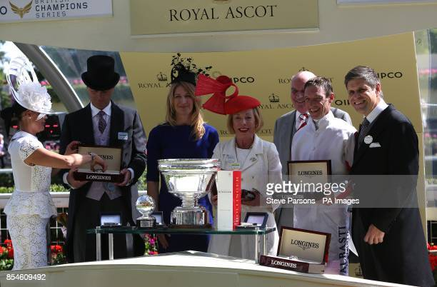 Former tennis player Steffi Graf hands over the winners trophy to Serbina Power owner of the horse Sole Power the winner of the King's Stand Stakes...