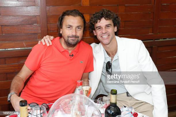 Former Tennis Players Henri Leconte and Gustavo Kuerten attend Roland Garros Tennis French Open 2013 Day 2 on May 27 2013 in Paris France