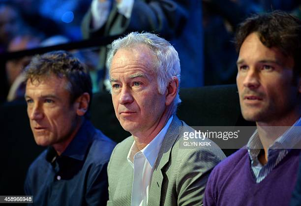 Former tennis players John McEnroe Carlos Moya and Mats Wilander attend the Group A singles match between Serbia's Novak Djokovic and Czech...