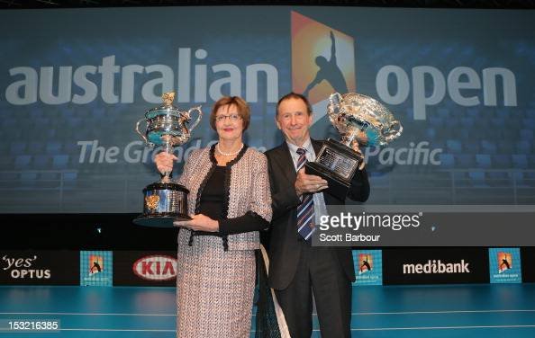 Former tennis players Margaret Court and Ashley Cooper pose with the Norman Brookes Challenge Cup and the Daphne Akhurst Trophy during the 2013...