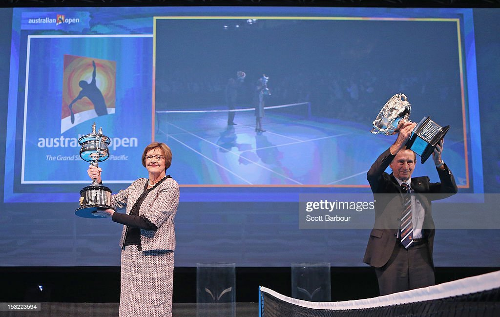 Former tennis players <a gi-track='captionPersonalityLinkClicked' href=/galleries/search?phrase=Margaret+Court&family=editorial&specificpeople=226911 ng-click='$event.stopPropagation()'>Margaret Court</a> and Ashley Cooper pose with the Norman Brookes Challenge Cup and the Daphne Akhurst Trophy during the 2013 Australian Open launch at Melbourne Park on October 2, 2012 in Melbourne, Australia.
