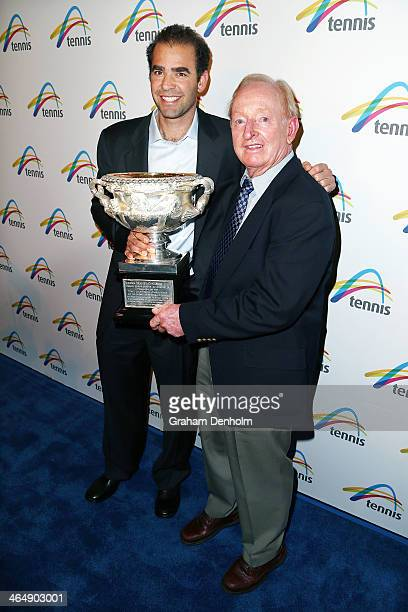Former tennis players Rod Laver and Pete Sampras pose with the Norman Brookes Challenge Cup as they arrive at the Legends Lunch during day 13 of the...