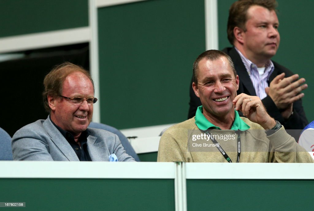 Former tennis players Wojciech Fibak (L) and <a gi-track='captionPersonalityLinkClicked' href=/galleries/search?phrase=Ivan+Lendl&family=editorial&specificpeople=242990 ng-click='$event.stopPropagation()'>Ivan Lendl</a> share a joke as they watch the action during day one of the final Davis Cup match between Czech Republic and Spain at the 02 Arena on November 16, 2012 in Prague, Czech Republic.