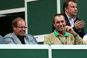 Former tennis players Wojciech Fibak and Ivan Lendl share a joke as they watch the action during day one of the final Davis Cup match between Czech...